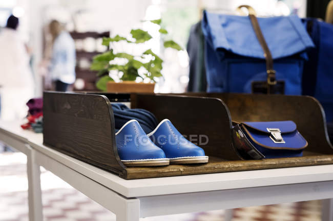 Shoes and bags displayed at store — Stock Photo