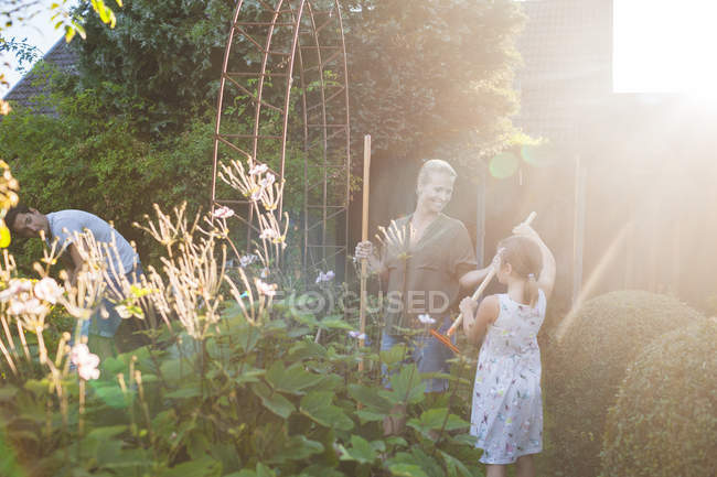 Happy family gardening together — Stock Photo