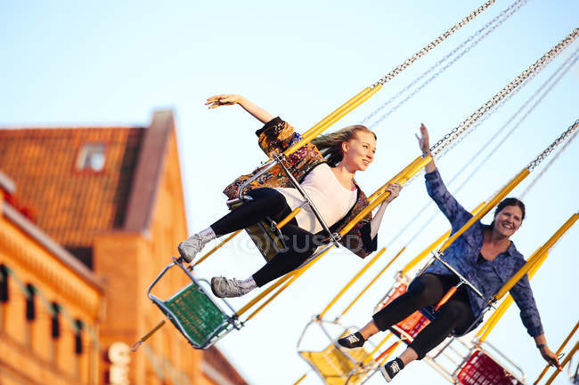 Young women on fairground ride — Stock Photo