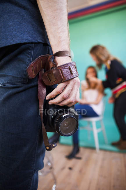 Photographer with camera and model in preparation — Stock Photo