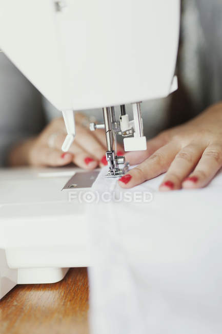 Fashion Designer Using Sewing Machine Color Image Selective Focus Best Using Sewing Machine For Beginners