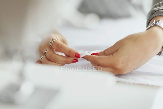 Fashion designer working with fabric — Stock Photo