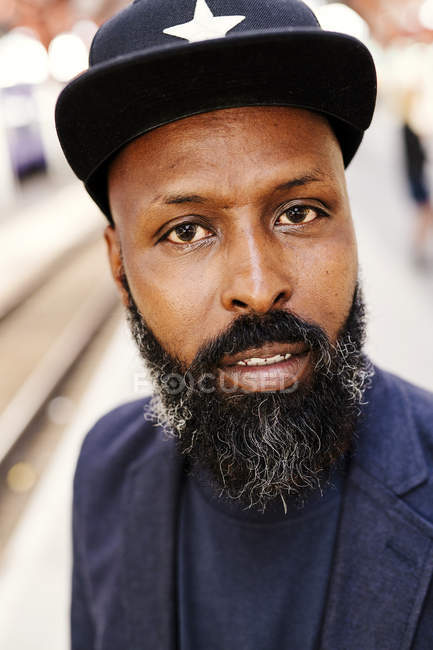 Confident man at railroad station — Stock Photo
