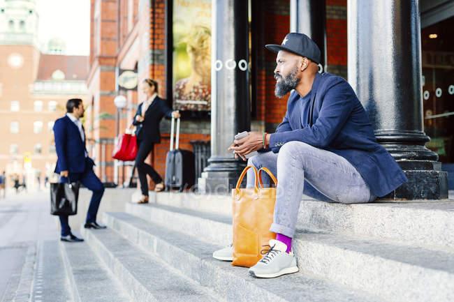 Thoughtful man sitting on steps — Stock Photo