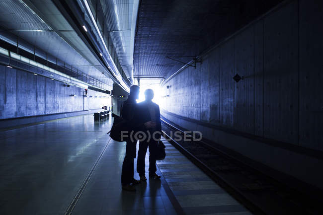 Silhouette businessmen at subway station — Stock Photo