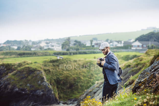 Man photographing on hill — Stock Photo