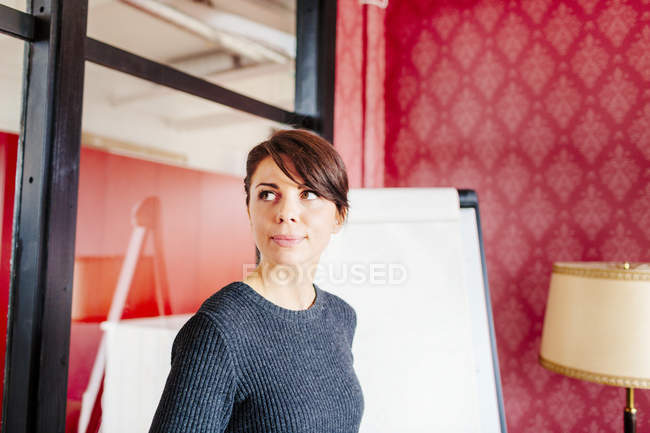 Thoughtful businesswoman in office — Stock Photo