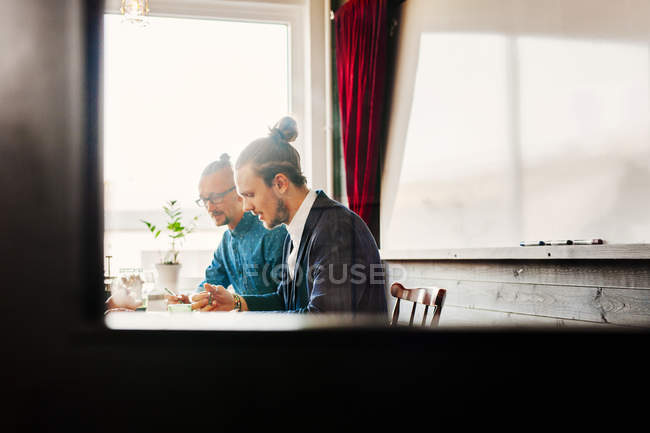 Businessmen working in creative office — Stock Photo