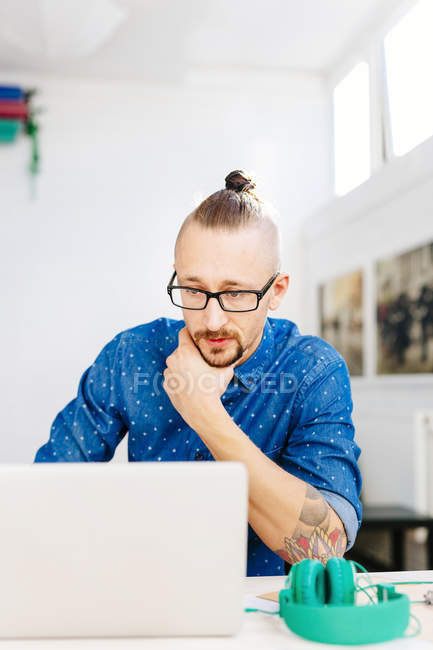 Serious businessman using laptop — Stock Photo