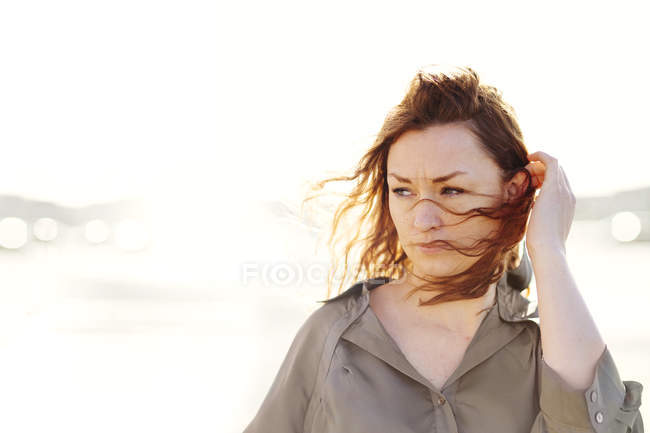 Woman with windswept hair outdoors — Stock Photo
