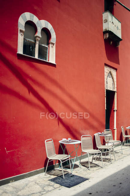 Chairs and tables at sidewalk — Stock Photo