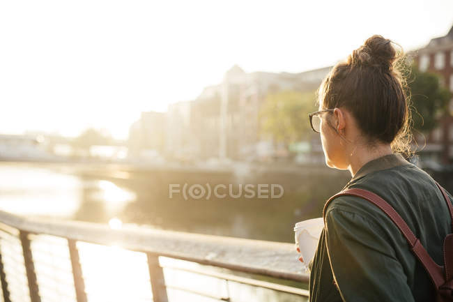 Woman standing by river — Stock Photo