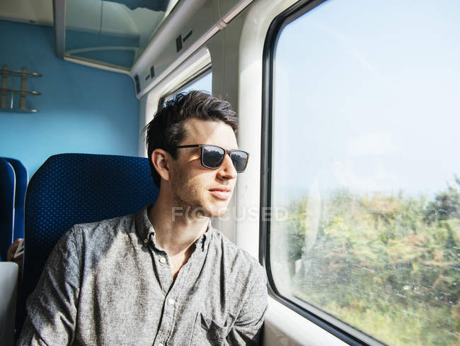 Thoughtful man in sunglasses — Stock Photo
