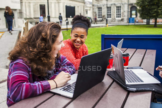 Cheerful female university students — Stock Photo