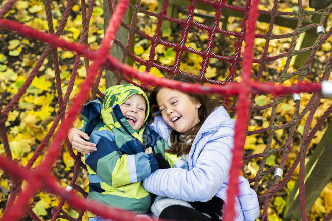 Playful brother and sister — Stock Photo