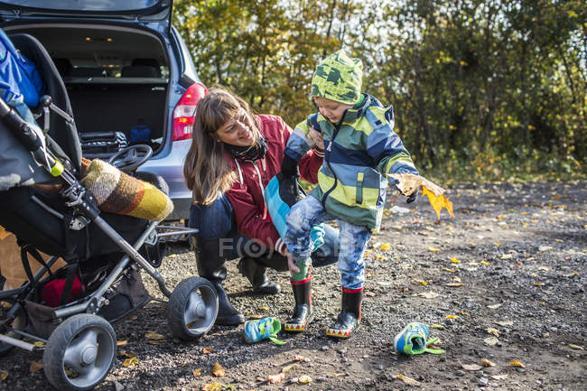 Mature mother assisting boy — Stock Photo