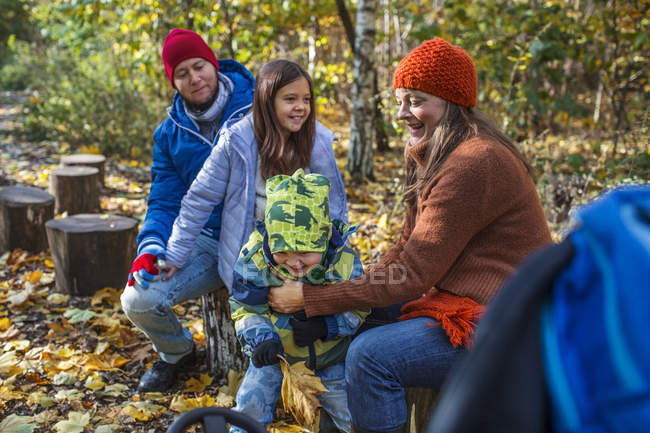 Happy family in forest — Stock Photo