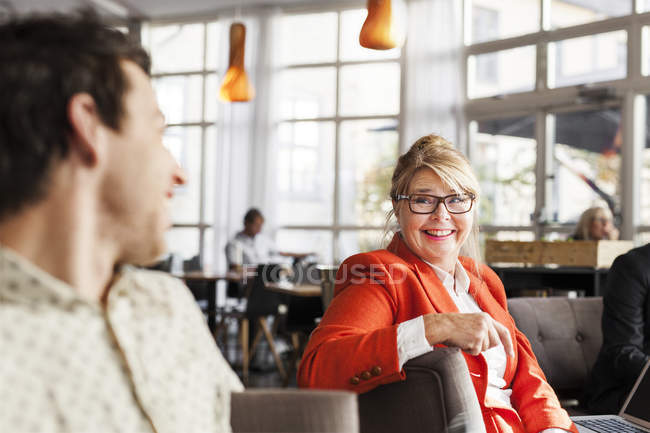 Happy business people discussing — Stock Photo