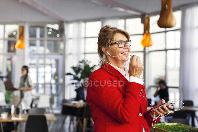 Appy businesswoman talking in restaurant — Stock Photo