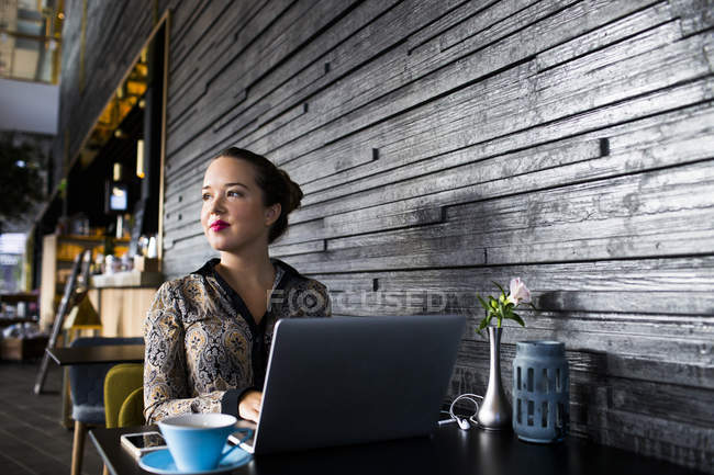 Beautiful businesswoman using laptop — Stock Photo