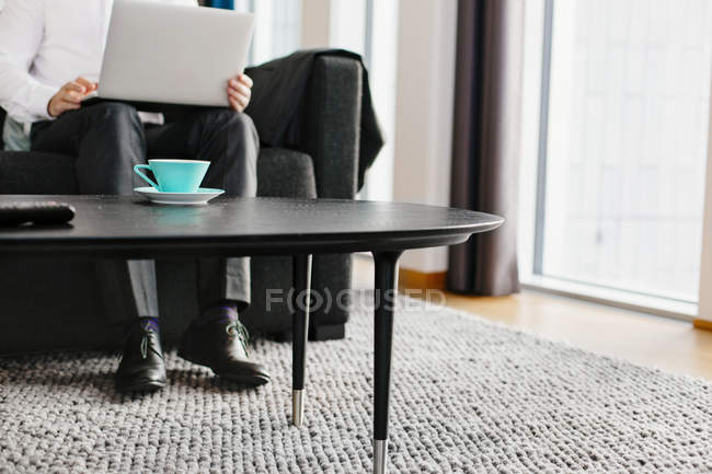 Businessman sitting with laptop — Stock Photo