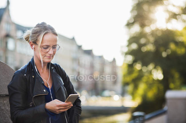 Mature woman with earphones — Stock Photo