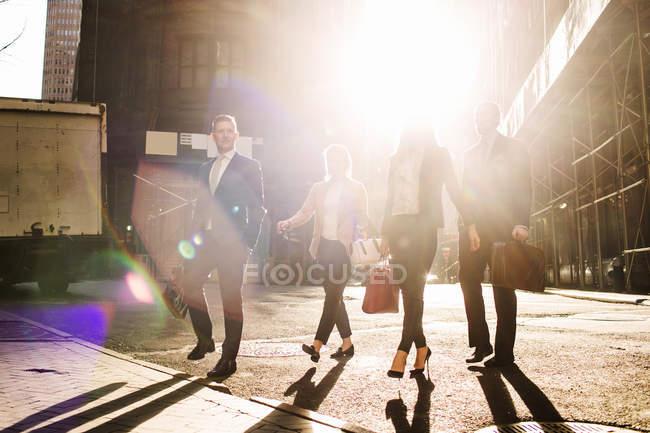 Business people walking on city street — Stock Photo