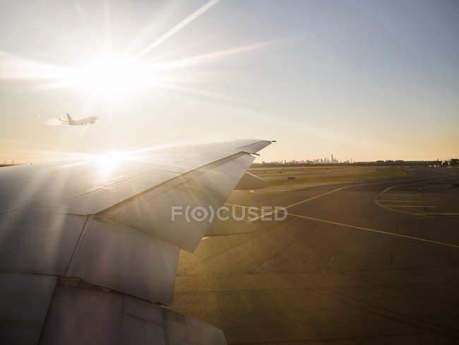 Airplane on airport runway — Stock Photo