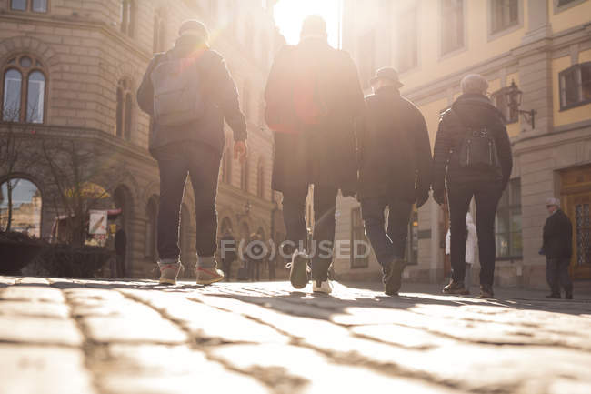 People walking in old town — Stock Photo