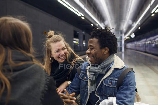 Friends having fun at subway station — Stock Photo