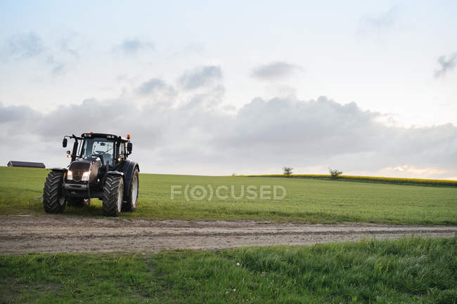 Tractor on grassy field — Stock Photo