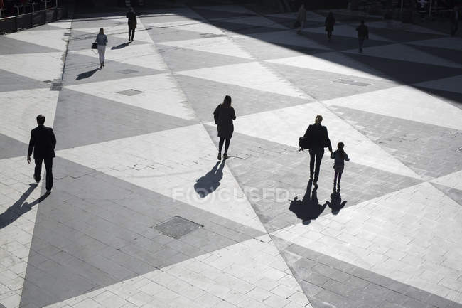People walking at town square — Stock Photo