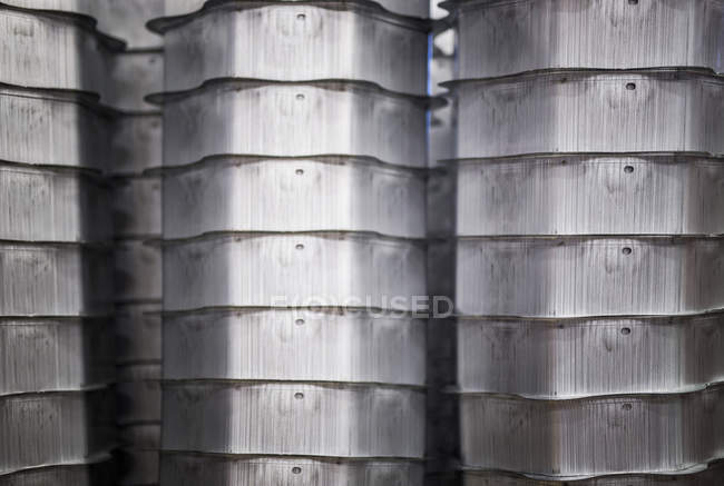 Stack of containers in factory — Stock Photo