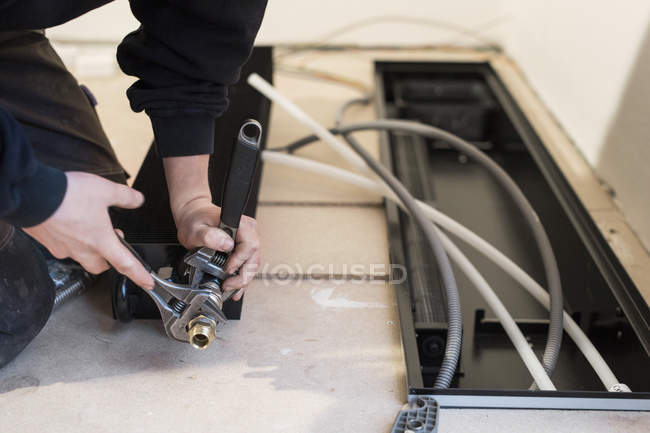 Repairman working with tools — Stock Photo