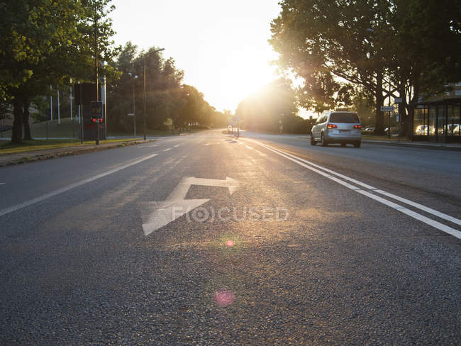 Car on street during sunny day — Stock Photo
