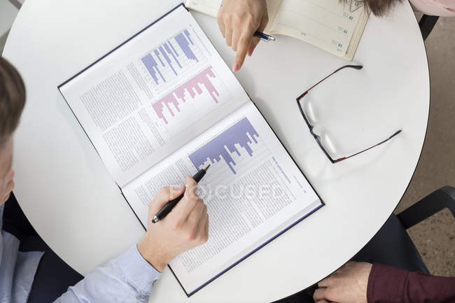 Business people analyzing graphs — Stock Photo