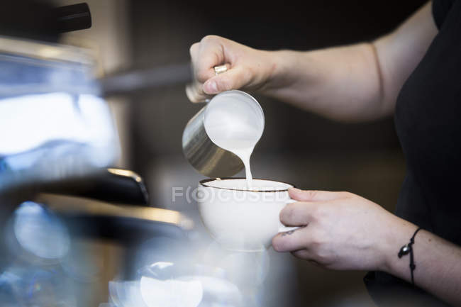Barista preparing cappuccino — Stock Photo