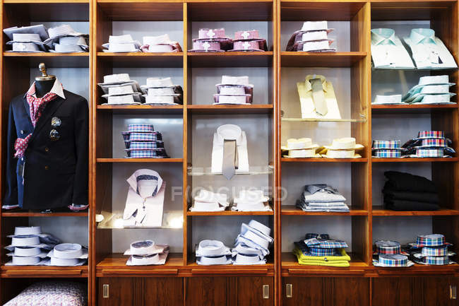 Shirts arranged in shelves — Stock Photo