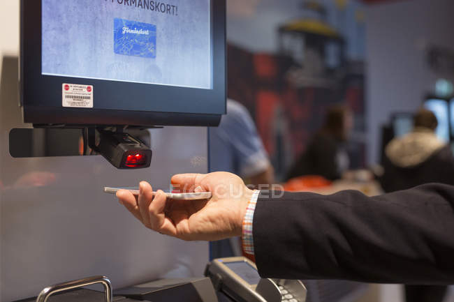 Male hand scanning credit card — Stock Photo