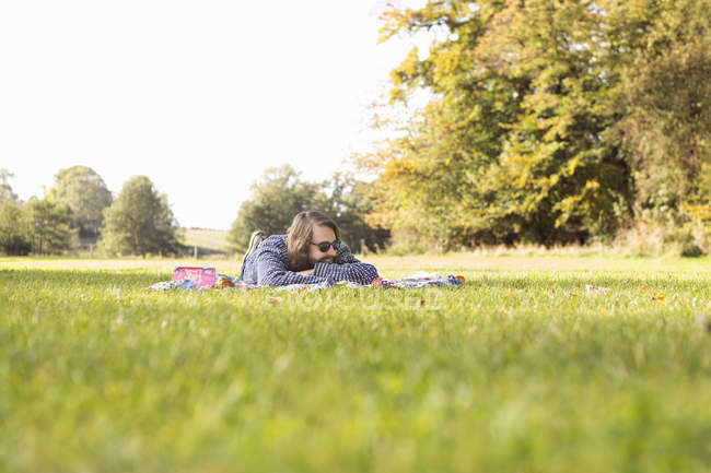 Young man relaxing on picnic — Stock Photo