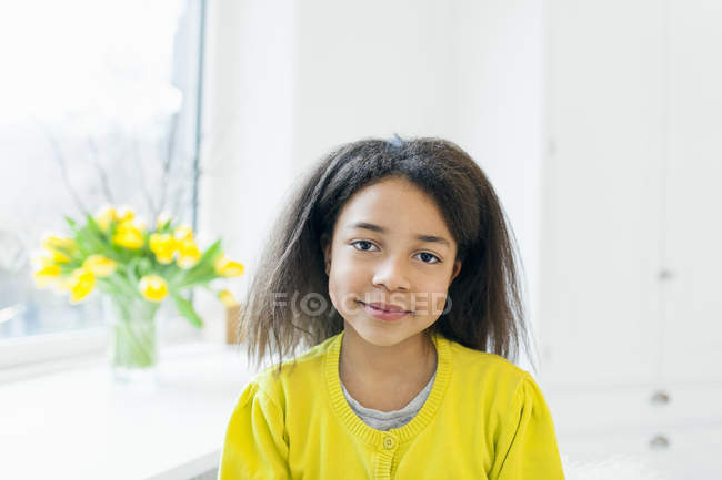 Happy girl with curly hair — Stock Photo