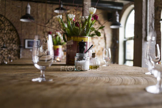 Flower vase on table in restaurant — Stock Photo