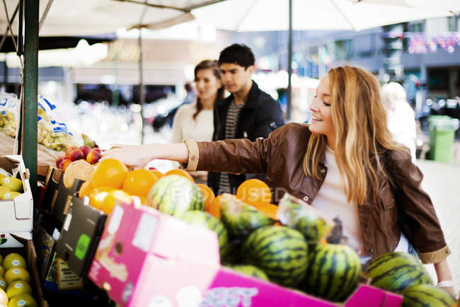People choosing fruits — Stock Photo