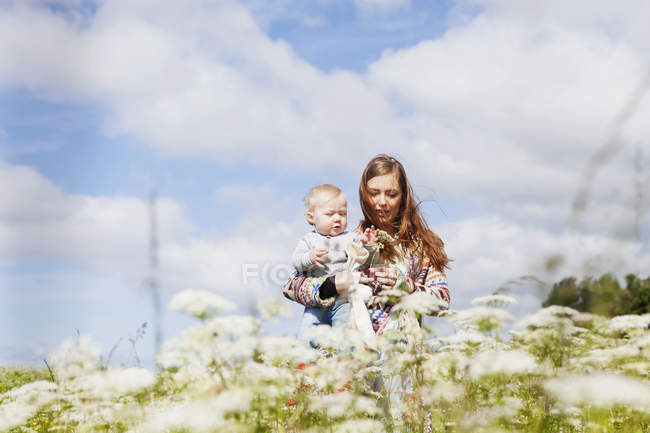 Mother holding son at beach — Stock Photo