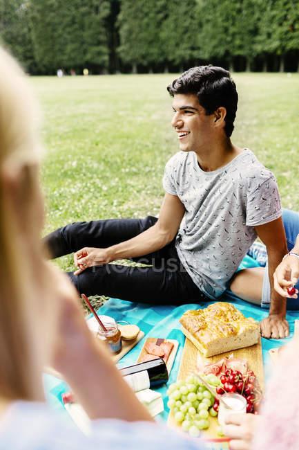 Happy man enjoying picnic — Stock Photo