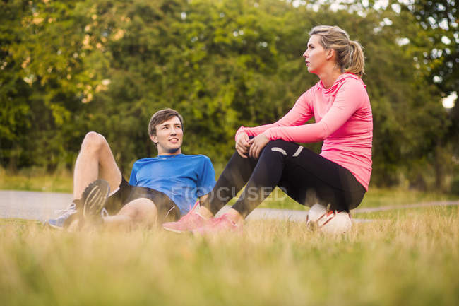 Man looking at woman at park — Stock Photo