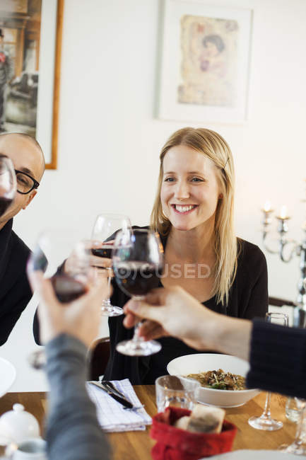 Happy woman toasting wineglasses — Stock Photo
