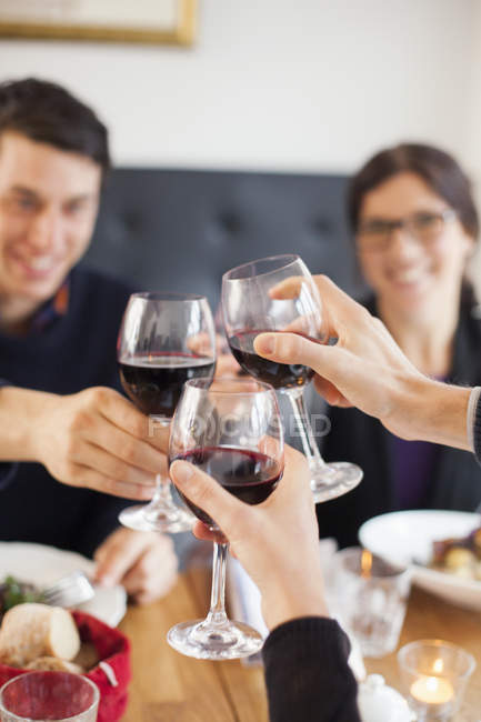 Friends toasting red wineglasses — Stock Photo