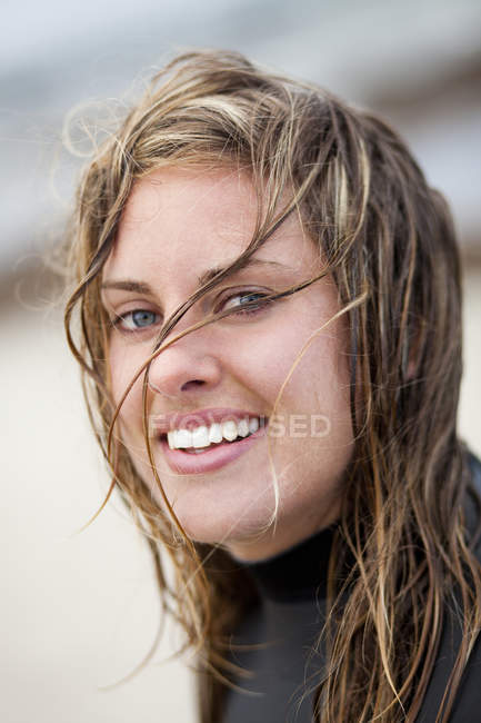 Happy wet woman at beach — Stock Photo