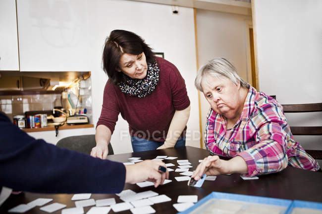 Healthcare worker assisting women — Stock Photo